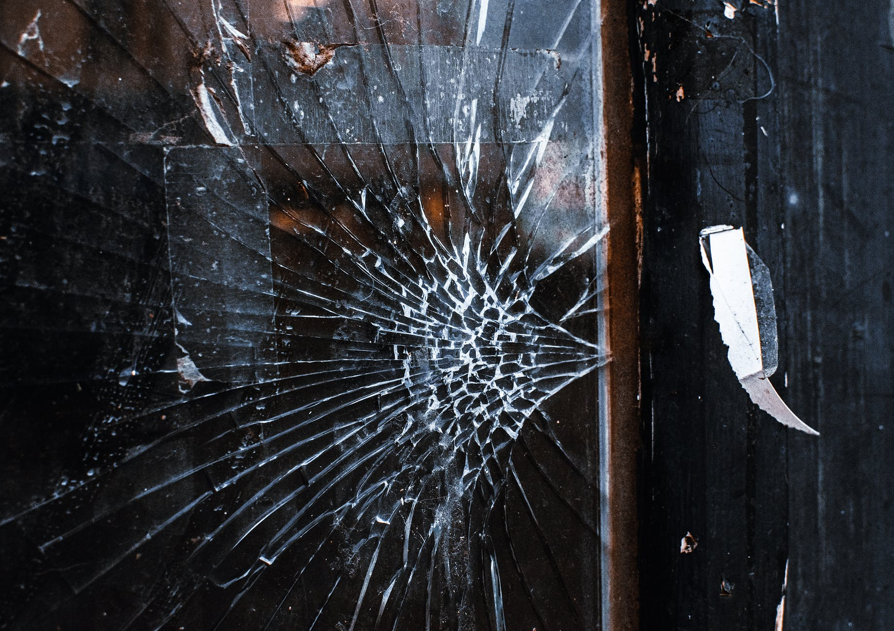 broken glass on wooden surface